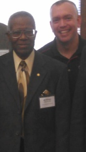 Neal with Bill Burton