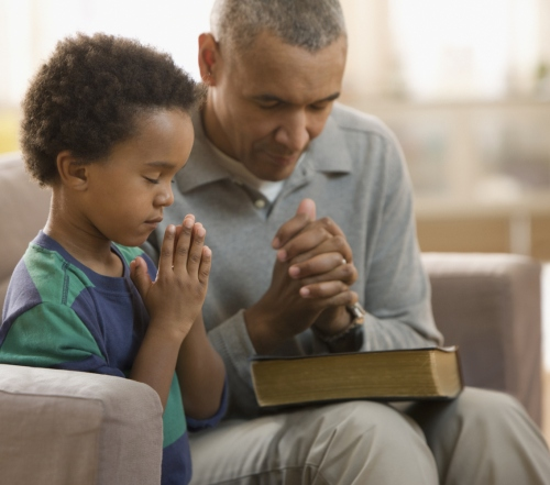 dad-and-son-pray-slide_405696_5101570_free