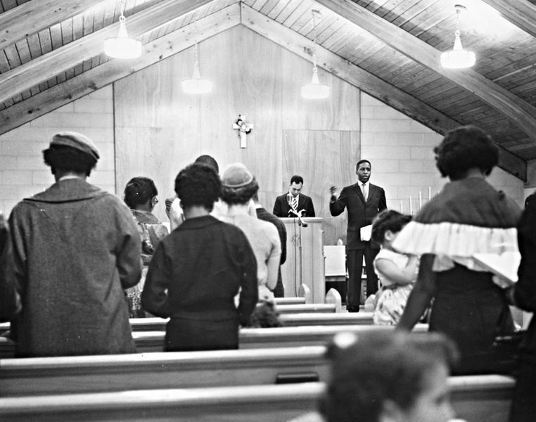762px-gerald_hughes_cleveland_school_teacher_leads_the_lee_heights_community_church_cleveland_ohio_congregation_in_song_1960_16458543170