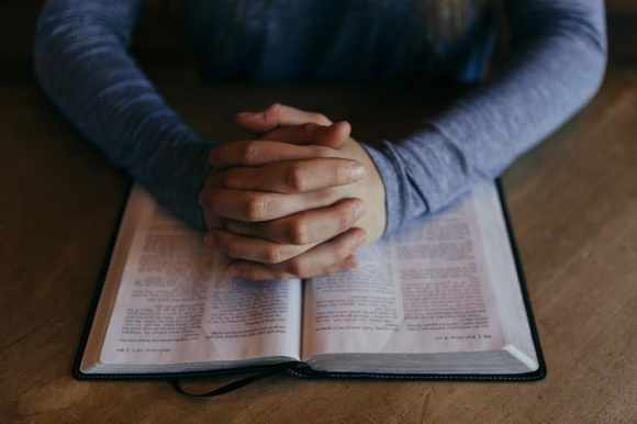 person-prayer-book-bible